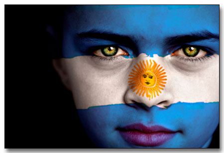 Portrait of a boy with the flag of Argentina painted on his face